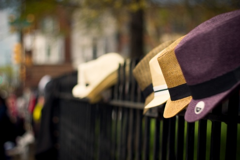 Hat hanging on a fence